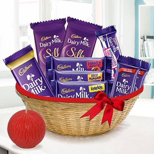 Delectable Dairy Milk Basket and Tea Light Deepawali Gift Combo