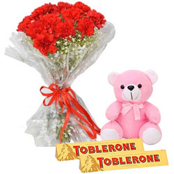 Cute Combo of Small Teddy with Red Carnation Bouquet N Toblerone Chocolate