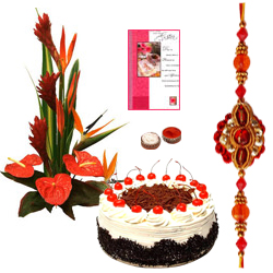 Mesmerizing Combo Gift Pack of Seasonal Flowers Bouquet, Bakery Fresh Cake and Card with free Rakhi, Roli Tilak and Chawal